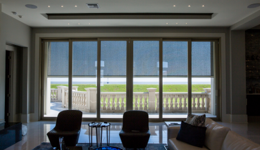 Outdoor motorized shades by Crown Shade Company